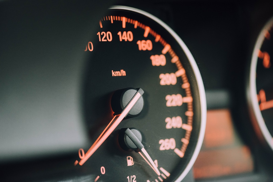 view of dashboard and car speedometer at a low speed