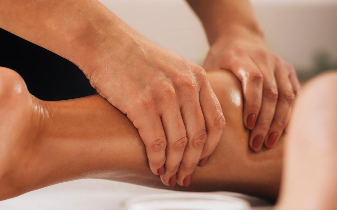 Person massaging a leg