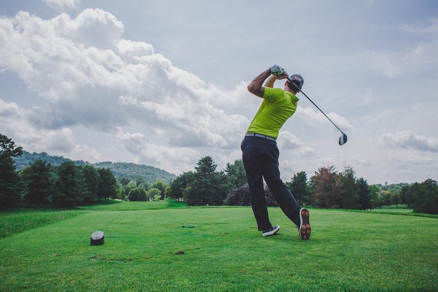 Man in green shirt playing golf