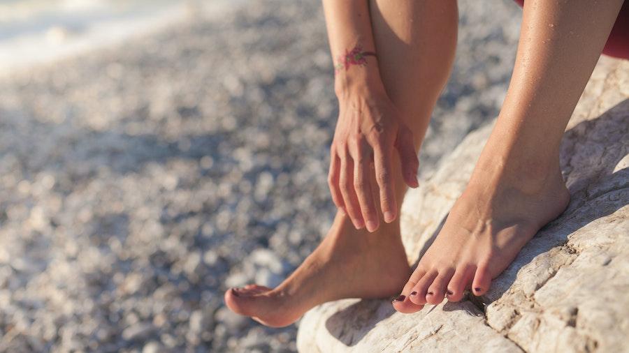 Feet standing on a rock